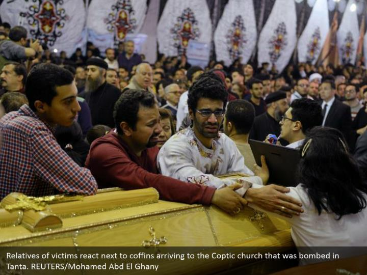 Relatives of victims react next to coffins arriving to the Coptic church that was bombed in Tanta. REUTERS/Mohamed Abd El Ghany