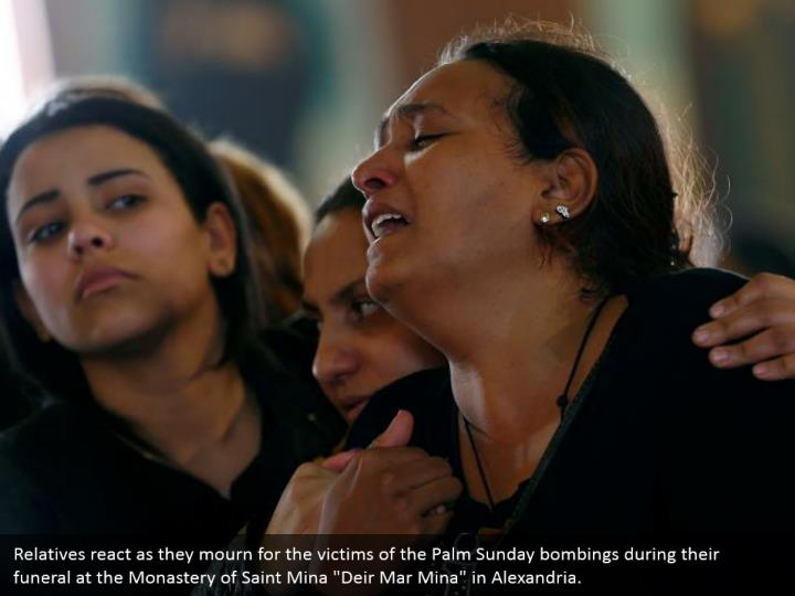 """Relatives react as they mourn for the victims of the Palm Sunday bombings during their funeral at the Monastery of Saint Mina """"Deir Mar Mina"""" in Alexandria."""