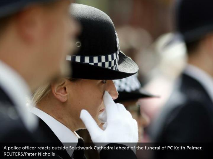 A police officer reacts outside Southwark Cathedral ahead of the funeral of PC Keith Palmer. REUTERS/Peter Nicholls