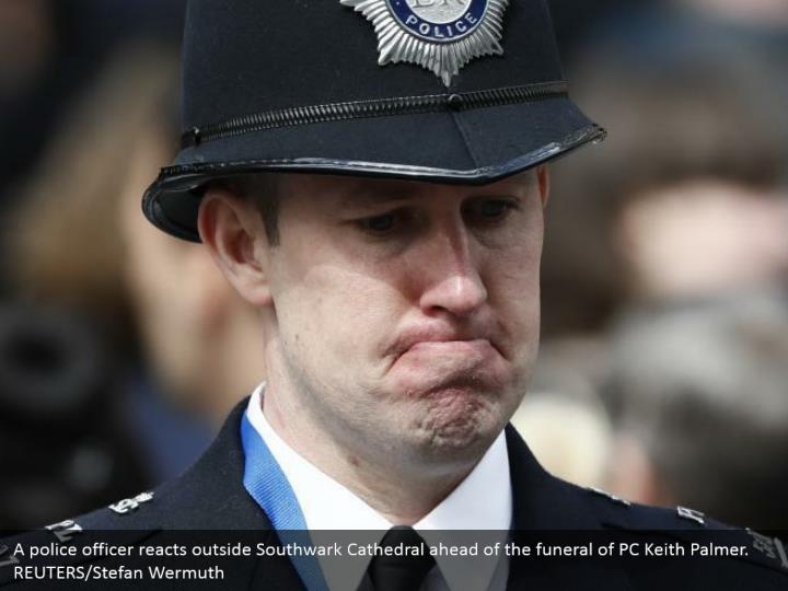 A police officer reacts outside Southwark Cathedral ahead of the funeral of PC Keith Palmer. REUTERS/Stefan Wermuth
