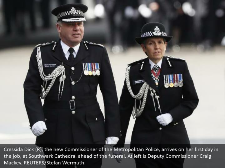 Cressida Dick (R), the new Commissioner of the Metropolitan Police, arrives on her first day in the job, at Southwark Cathedral ahead of the funeral. At left is Deputy Commissioner Craig Mackey. REUTERS/Stefan Wermuth