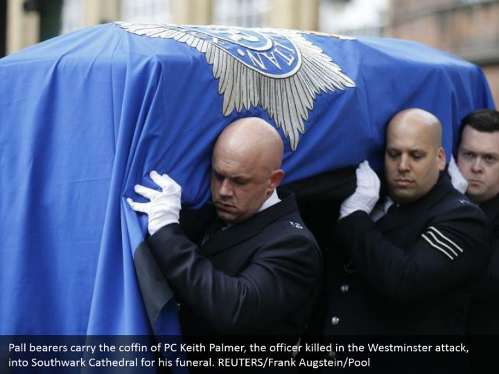 Pall bearers carry the coffin of PC Keith Palmer, the officer killed in the Westminster attack, into Southwark Cathedral for his funeral. REUTERS/Frank Augstein/Pool