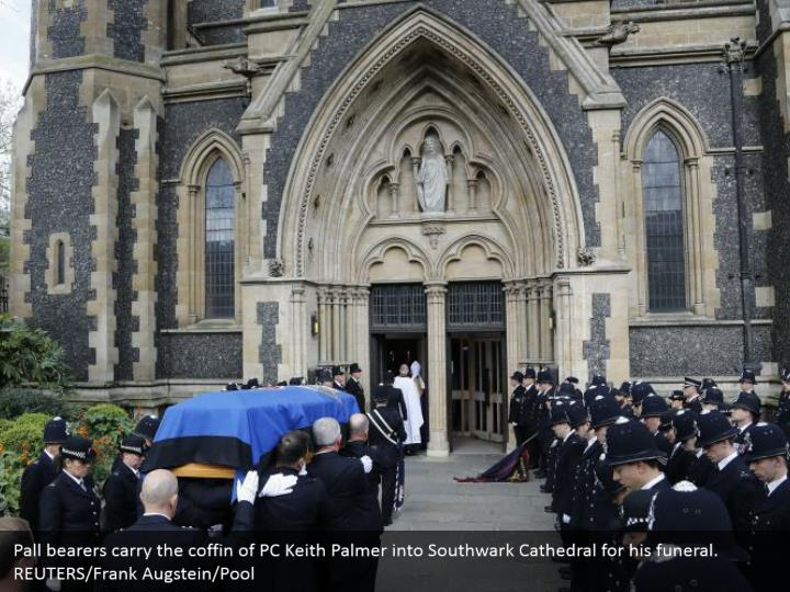 Pall bearers carry the coffin of PC Keith Palmer into Southwark Cathedral for his funeral. REUTERS/Frank Augstein/Pool