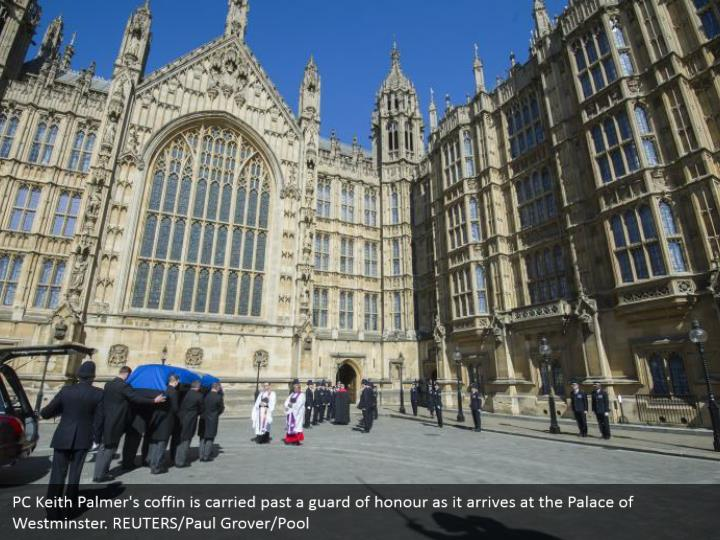 PC Keith Palmer's coffin is carried past a guard of honour as it arrives at the Palace of Westminster. REUTERS/Paul Grover/Pool
