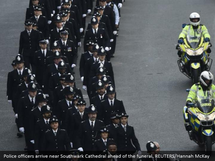 Police officers arrive near Southwark Cathedral ahead of the funeral. REUTERS/Hannah McKay