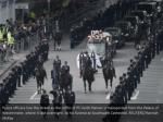 police officers line the street as the coffin1