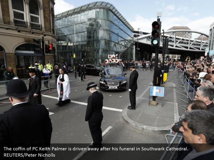 The coffin of PC Keith Palmer is driven away after his funeral in Southwark Cathedral. REUTERS/Peter Nicholls