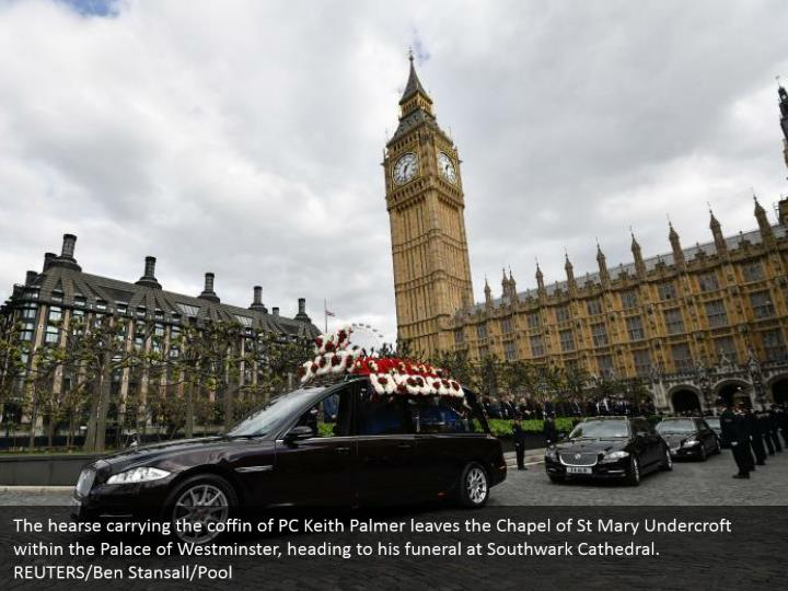 The hearse carrying the coffin of PC Keith Palmer leaves the Chapel of St Mary Undercroft within the Palace of Westminster, heading to his funeral at Southwark Cathedral. REUTERS/Ben Stansall/Pool