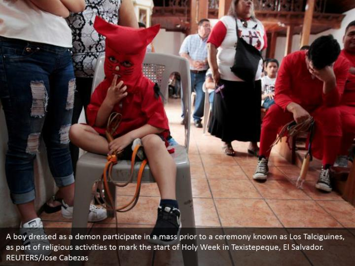 A boy dressed as a demon participate in a mass prior to a ceremony known as Los Talciguines, as part of religious activities to mark the start of Holy Week in Texistepeque, El Salvador. REUTERS/Jose Cabezas