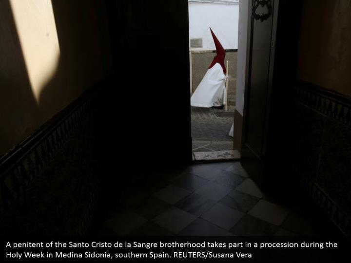 A penitent of the Santo Cristo de la Sangre brotherhood takes part in a procession during the Holy Week in Medina Sidonia, southern Spain. REUTERS/Susana Vera