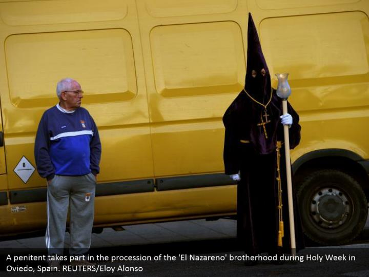 A penitent takes part in the procession of the 'El Nazareno' brotherhood during Holy Week in Oviedo, Spain. REUTERS/Eloy Alonso