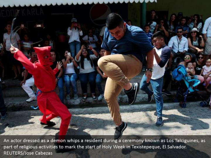 An actor dressed as a demon whips a resident during a ceremony known as Los Talciguines, as part of religious activities to mark the start of Holy Week in Texistepeque, El Salvador. REUTERS/Jose Cabezas