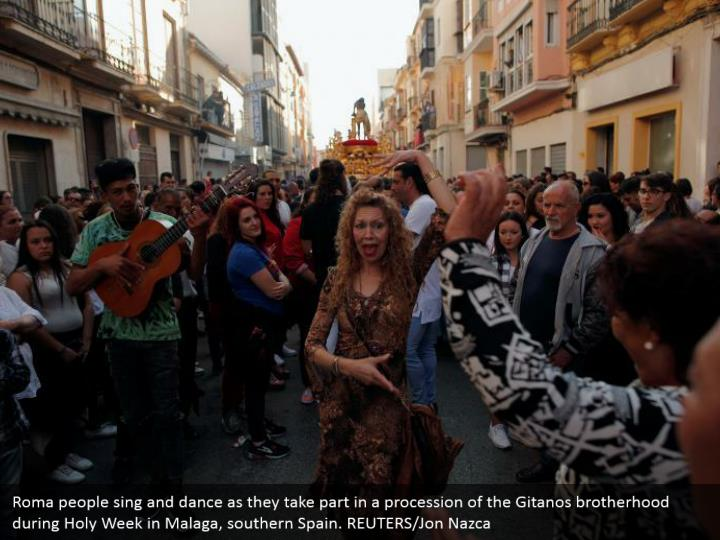 Roma people sing and dance as they take part in a procession of the Gitanos brotherhood during Holy Week in Malaga, southern Spain. REUTERS/Jon Nazca