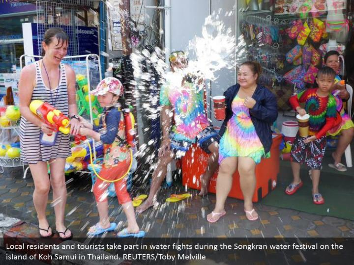 Local residents and tourists take part in water fights during the Songkran water festival on the island of Koh Samui in Thailand. REUTERS/Toby Melville