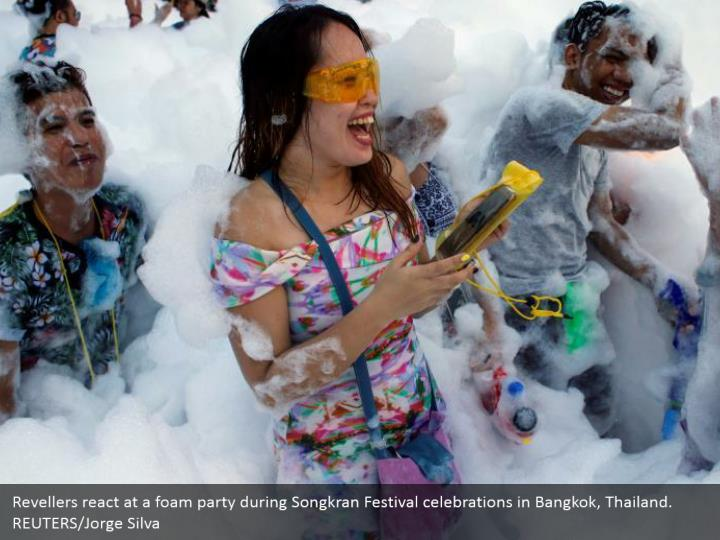 Revellers react at a foam party during Songkran Festival celebrations in Bangkok, Thailand. REUTERS/Jorge Silva