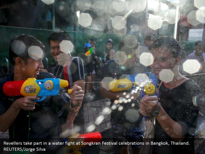 Revellers take part in a water fight at songkran