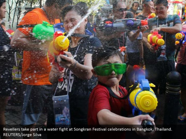 Revellers take part in a water fight at Songkran Festival celebrations in Bangkok, Thailand. REUTERS/Jorge Silva