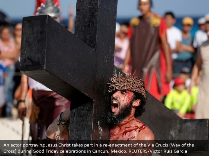 An actor portraying Jesus Christ takes part in a re-enactment of the Via Crucis (Way of the Cross) during Good Friday celebrations in Cancun, Mexico. REUTERS/Victor Ruiz Garcia