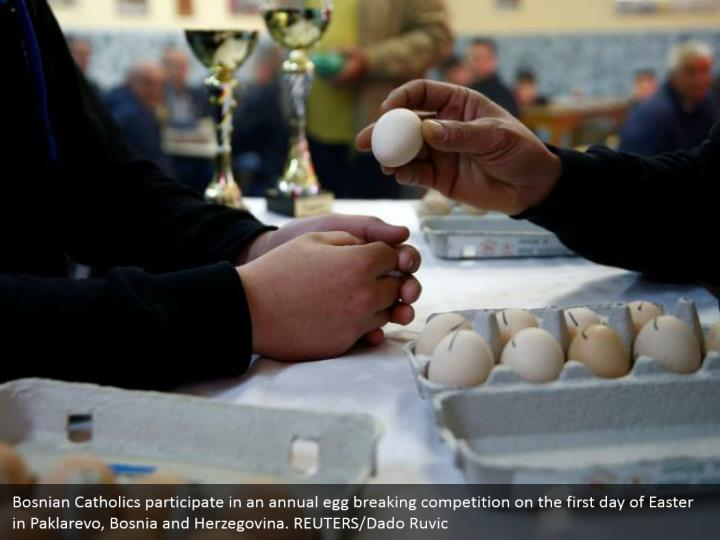 Bosnian Catholics participate in an annual egg breaking competition on the first day of Easter in Paklarevo, Bosnia and Herzegovina. REUTERS/Dado Ruvic