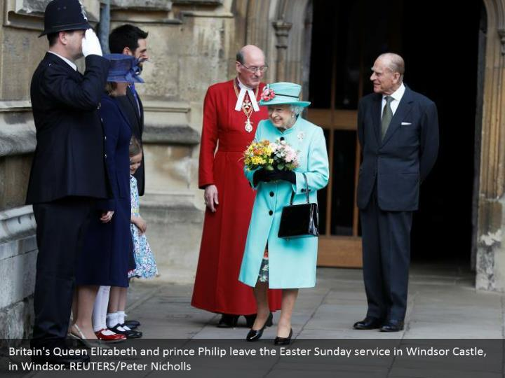 Britain's Queen Elizabeth and prince Philip leave the Easter Sunday service in Windsor Castle, in Windsor. REUTERS/Peter Nicholls