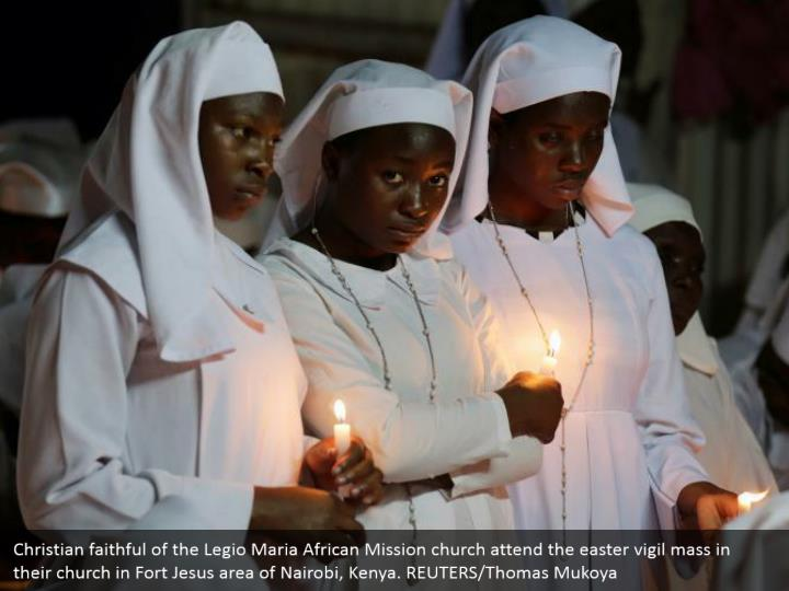 Christian faithful of the Legio Maria African Mission church attend the easter vigil mass in their church in Fort Jesus area of Nairobi, Kenya. REUTERS/Thomas Mukoya