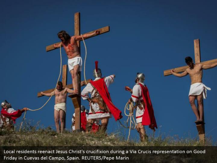 Local residents reenact Jesus Christ's crucifixion during a Via Crucis representation on Good Friday in Cuevas del Campo, Spain. REUTERS/Pepe Marin