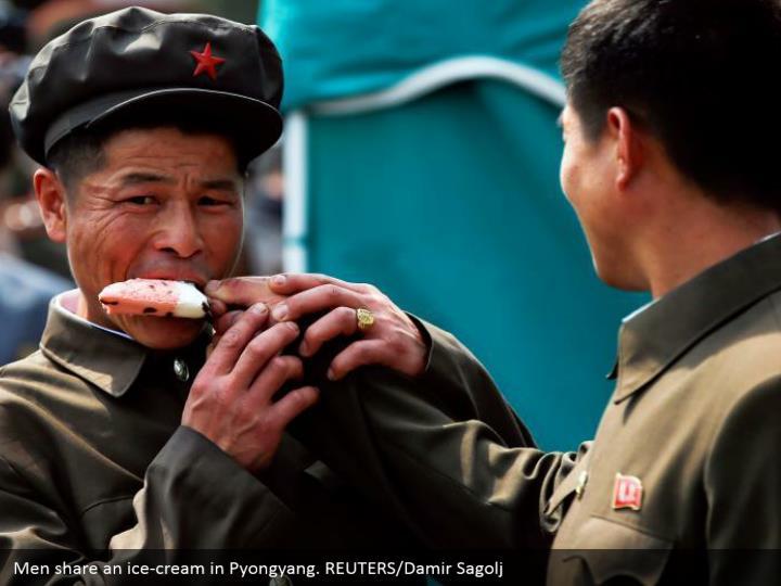 Men share an ice cream in pyongyang reuters damir