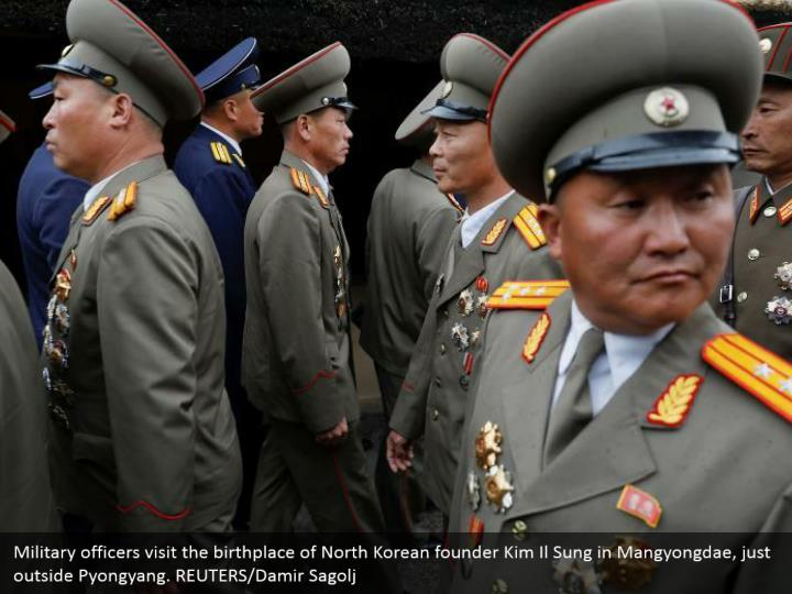 Military officers visit the birthplace of North Korean founder Kim Il Sung in Mangyongdae, just outside Pyongyang. REUTERS/Damir Sagolj