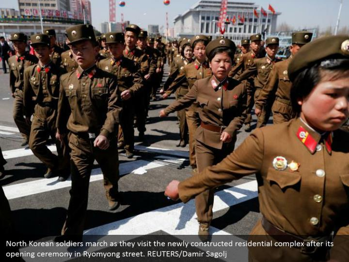 North Korean soldiers march as they visit the newly constructed residential complex after its opening ceremony in Ryomyong street. REUTERS/Damir Sagolj