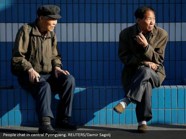 People chat in central Pyongyang. REUTERS/Damir Sagolj
