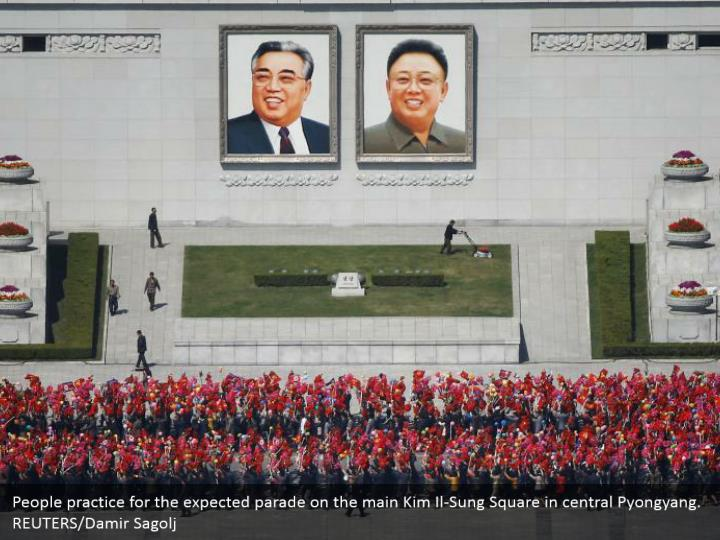 People practice for the expected parade on the main Kim Il-Sung Square in central Pyongyang. REUTERS/Damir Sagolj