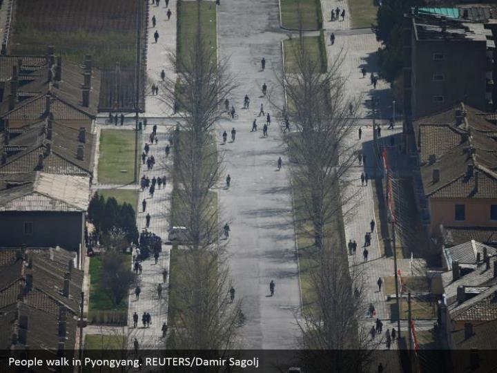 People walk in Pyongyang. REUTERS/Damir Sagolj