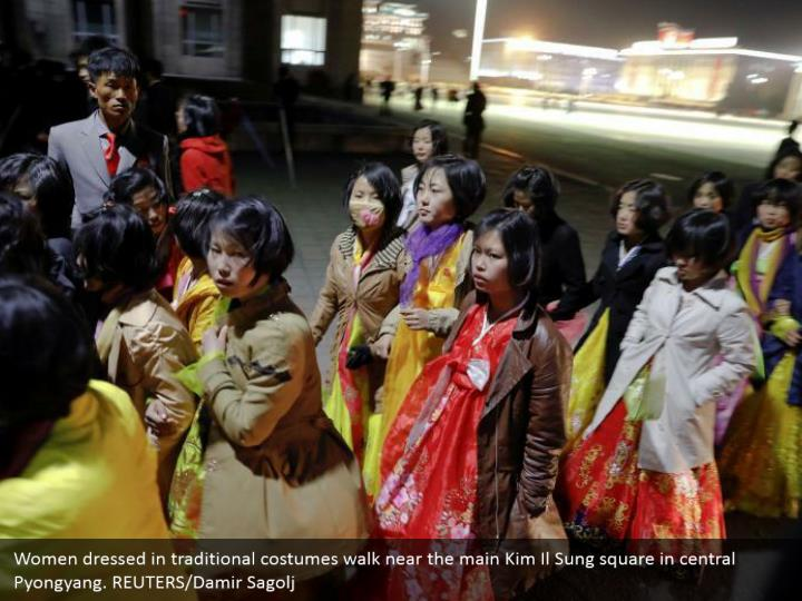 Women dressed in traditional costumes walk near the main Kim Il Sung square in central Pyongyang. REUTERS/Damir Sagolj