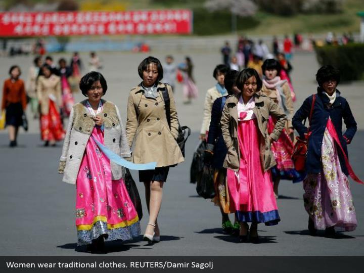 Women wear traditional clothes. REUTERS/Damir Sagolj