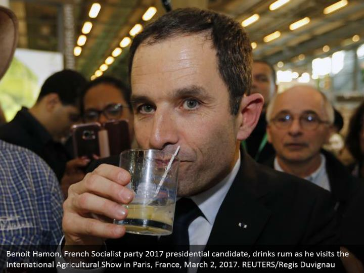 Benoit Hamon, French Socialist party 2017 presidential candidate, drinks rum as he visits the International Agricultural Show in Paris, France, March 2, 2017. REUTERS/Regis Duvignau