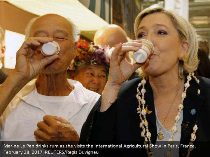 Marine Le Pen drinks rum as she visits the International Agricultural Show in Paris, France, February 28, 2017. REUTERS/Regis Duvignau