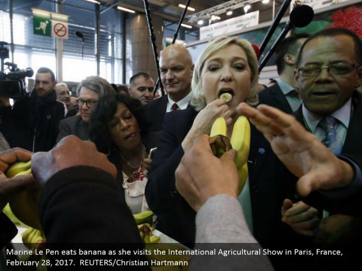 Marine Le Pen eats banana as she visits the International Agricultural Show in Paris, France, February 28, 2017.  REUTERS/Christian Hartmann