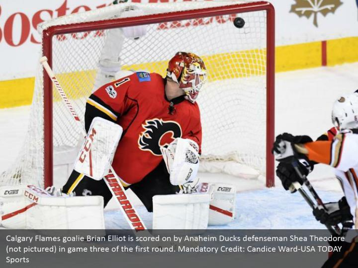 Calgary Flames goalie Brian Elliot is scored on by Anaheim Ducks defenseman Shea Theodore (not pictured) in game three of the first round. Mandatory Credit: Candice Ward-USA TODAY Sports