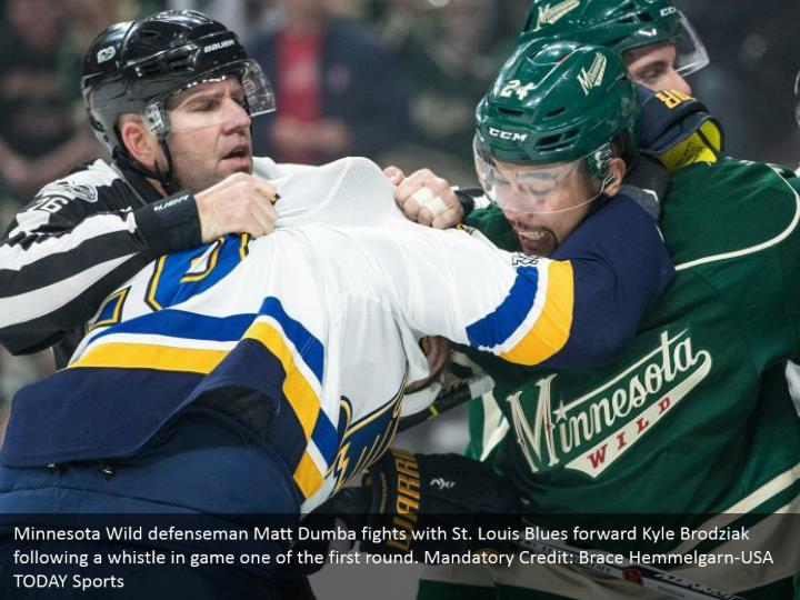 Minnesota Wild defenseman Matt Dumba fights with St. Louis Blues forward Kyle Brodziak following a whistle in game one of the first round. Mandatory Credit: Brace Hemmelgarn-USA TODAY Sports