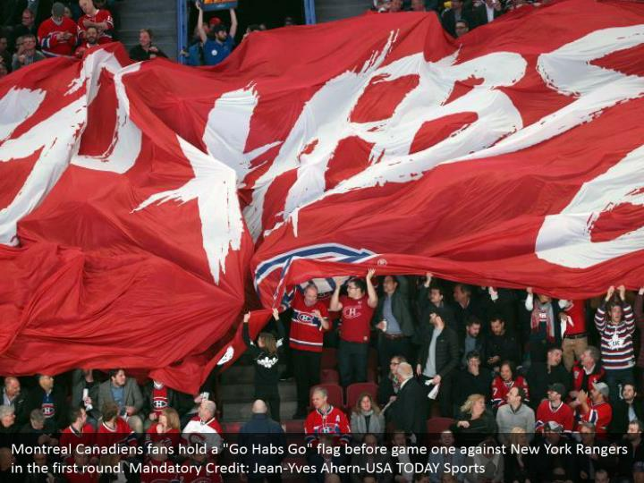 "Montreal Canadiens fans hold a ""Go Habs Go"" flag before game one against New York Rangers in the first round. Mandatory Credit: Jean-Yves Ahern-USA TODAY Sports"