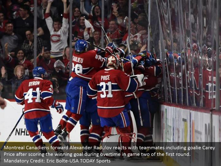 Montreal Canadiens forward Alexander Radulov reacts with teammates including goalie Carey Price after scoring the winning goal during overtime in game two of the first round. Mandatory Credit: Eric Bolte-USA TODAY Sports
