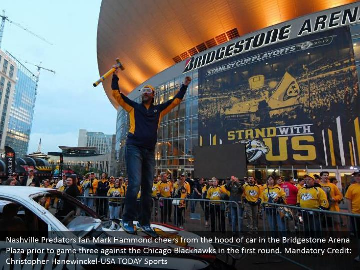 Nashville Predators fan Mark Hammond cheers from the hood of car in the Bridgestone Arena Plaza prior to game three against the Chicago Blackhawks in the first round. Mandatory Credit: Christopher Hanewinckel-USA TODAY Sports