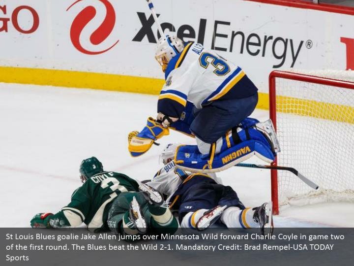 St Louis Blues goalie Jake Allen jumps over Minnesota Wild forward Charlie Coyle in game two of the first round. The Blues beat the Wild 2-1. Mandatory Credit: Brad Rempel-USA TODAY Sports