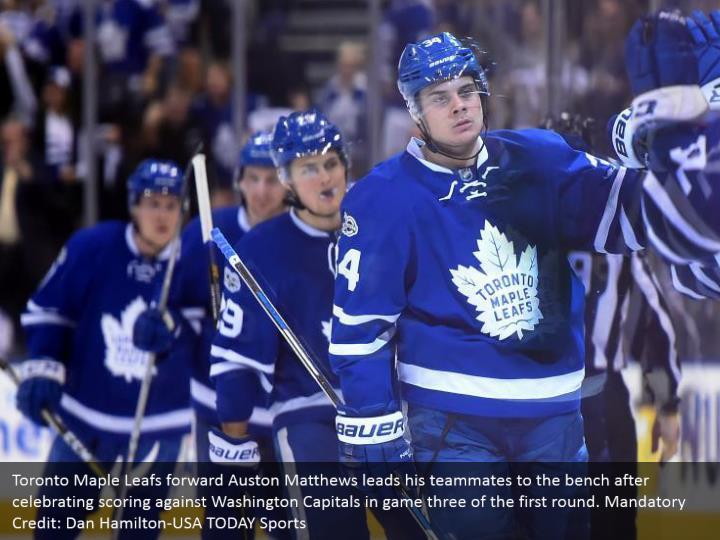 Toronto Maple Leafs forward Auston Matthews leads his teammates to the bench after celebrating scoring against Washington Capitals in game three of the first round. Mandatory Credit: Dan Hamilton-USA TODAY Sports