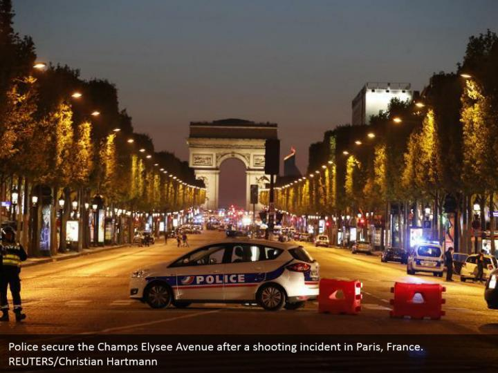 Police secure the Champs Elysee Avenue after a shooting incident in Paris, France. REUTERS/Christian Hartmann