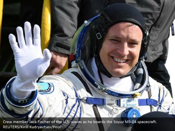 Crew member Jack Fischer of the U.S. waves as he boards the Soyuz MS-04 spacecraft. REUTERS/Kirill Kudryavtsev/Pool