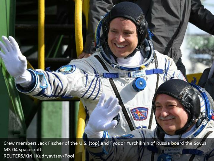Crew members Jack Fischer of the U.S. (top) and Fyodor Yurchikhin of Russia board the Soyuz MS-04 spacecraft.   REUTERS/Kirill Kudryavtsev/Pool