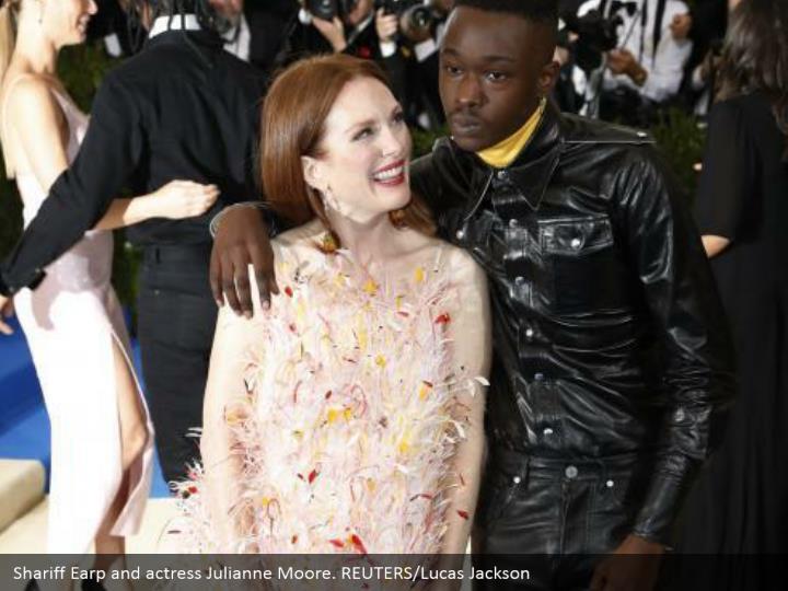 Shariff Earp and actress Julianne Moore. REUTERS/Lucas Jackson