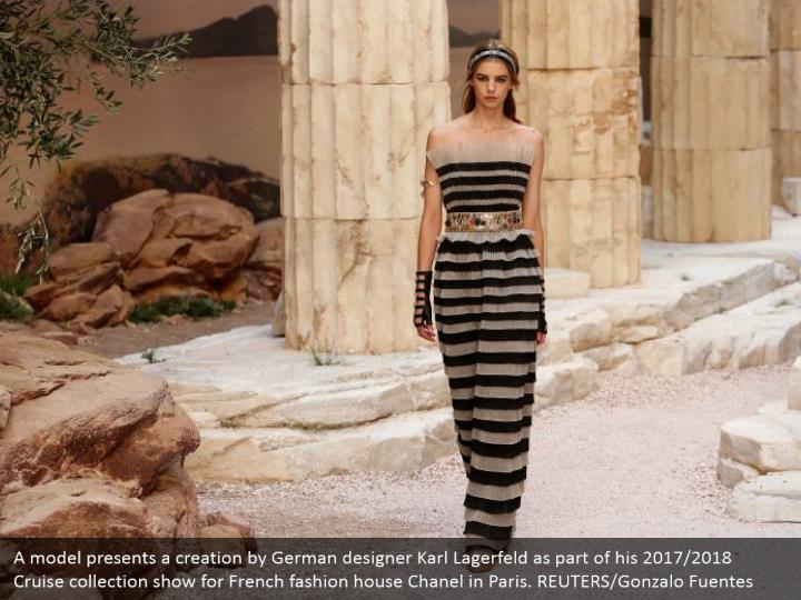 A model presents a creation by German designer Karl Lagerfeld as part of his 2017/2018 Cruise collection show for French fashion house Chanel in Paris. REUTERS/Gonzalo Fuentes