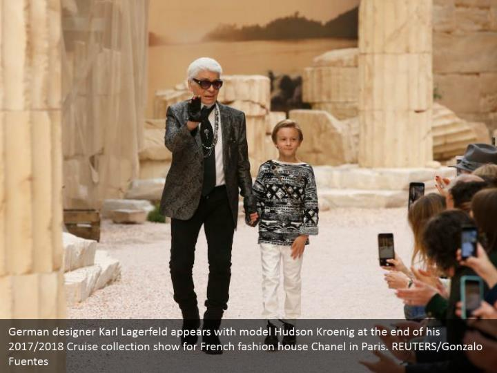 German designer Karl Lagerfeld appears with model Hudson Kroenig at the end of his 2017/2018 Cruise collection show for French fashion house Chanel in Paris. REUTERS/Gonzalo Fuentes